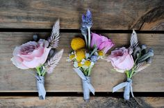 Don't forget that boutonnières don't have to match! Selecting different flowers from your bouquet for each one would be a great way to achieve an electic yet cohesive look for your wedding.