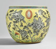 A yellow-ground grisaille-enameled fish bowl, Qing dynasty, Dayazhai mark…