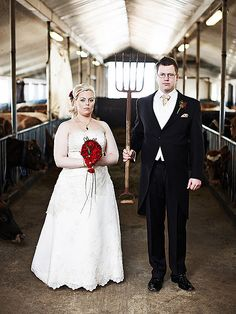 "Lárus Sigurðarson  -  A barn'ey weddin' pitcher -  A barn'ey weddin' pitcher    ---     This is Unnur and Ástmar who got married on the 11th of April.  It was a country wedding, the ceremony was at Skálholtskirkja and they wanted me to shoot them on a farm closeby that Unnur spent lots of time as a child, sort of the family farm for her, and now his as well.    The shot is an obvious spoof of the famous painting ""American Gothinc""."