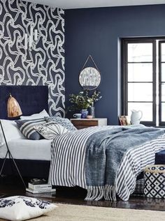 A limited palette of blue, white and copper makes it easy to use bold patterns. Mix nautical stripes and rope motifs with seashore flora and fauna designs for a rich scheme inspired by the ocean.