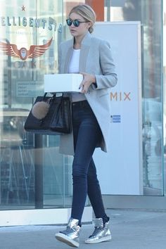 Gigi Hadid wearing Saint Laurent Classic Sac De Jour Leather Tote, Krewe Du Optic St. Louis Sunglasses and Tom Ford Metallic High-Top Sneakers