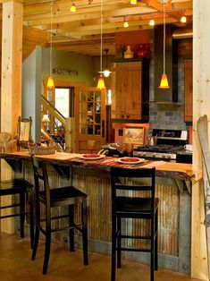 I like this! A creative use of tin to decorate the kitchen. Might have to build my future bar like this.