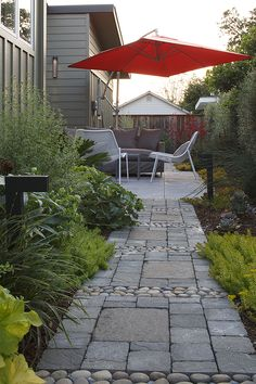 Mixing cut stone and river stone in this path creates an interesting modern aesthetic, by Alper Architect.