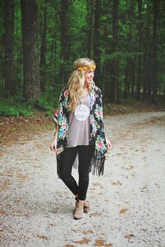 Boho/rock n' roll outfit: fringe kimono jacket; graphic tee; black skinny pants; ankle boots