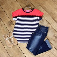 The Katy Striped Top is right on trend. This super soft top features a solid coral bodice and shoulders with ivory and navy striped easy fit body.