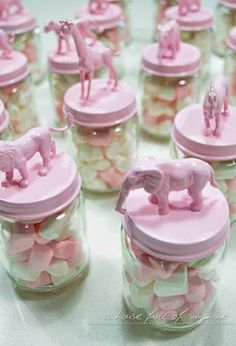 Paint some fun colors onto animal figurines and attach them to mason jars for cute and easy DIY  birthday party favors for kids.