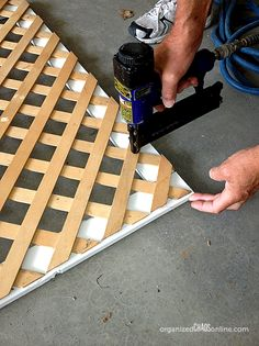 how to make an easy patio privacy screen step by step tutorial, outdoor living, Attaching the lattice to the frame