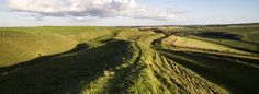 Maiden Castle. Among the largest and most complex of Iron Age hillforts in Europe, Maiden Castle's huge multiple ramparts enclose an area the size of 50 football pitches and once protected hundreds of residents.