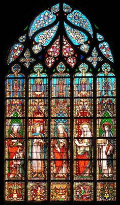 Stained glass windows in the Église Notre-Dame des Victoires (church of Our Lady of victories) at the Sablon in Brussels, Belgium