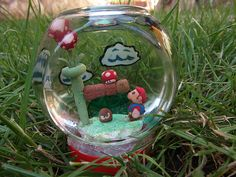 Super Mario snowglobe Super Mario, Snow Globes, Artwork, Inspiration, Decor, Biblical Inspiration, Work Of Art, Decoration, Auguste Rodin Artwork