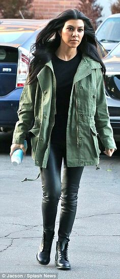 Stylish: The reality star paired black leather leggings with lace-up boots