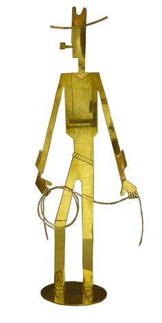 Stylized brass cowboy sculpture - Austria,1930's - Hagenauer Werkstatten - designer Franz Hagenauer.