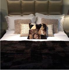 Dark Brown Shorn Lamb Bed-scarf, Light Grey Tibetan Lamb and Toscana Lamb Cushions.