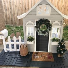 Another was turned into a Christmas-themed home, complete with festive mat, Christmas tree, bell and wreath (pictured) – playhouse Girls Playhouse, Backyard Playhouse, Build A Playhouse, Backyard Playground, Painted Playhouse, Playhouse Ideas, Little Tykes Playhouse, Costco Playhouse, Playhouse Decor