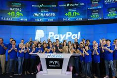 Paypal CEO Dan Schulman (C) celebrates with employees during the company's relisting on the Nasdaq in New York, July 20, 2015. PayPal Holdings Inc shares jumped as much as 11 percent in their highly anticipated return to the Nasdaq on Monday, valuing the company at about $52 billion. REUTERS/Lucas Jackson  - RTX1L2ED