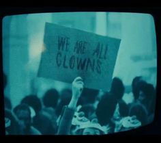 """In the newest trailer for """"Joker"""" a protester holds a sign that reads """"We are all clowns"""". This is a blatant promo for IT Chapter 2 which is also a WB movie. Aesthetic Images, Aesthetic Grunge, Aesthetic Vintage, Blue Aesthetic, Aesthetic Wallpapers, Playlists, Joker And Harley, Character Aesthetic, The Villain"""
