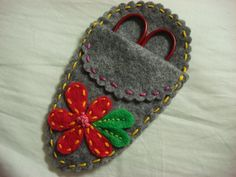 feeling stitchy: Tutorial Tuesday - To make your own embroidered scissor case/sheath you will need: - felt in assorted colors - embroidery supplies (floss, scissors, needles) - pinking shears or decorative scissors