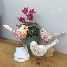 Handmade fabric bird. Tilda and vintage floral fabric. Carefully stitched and finished with floral wings with tiny white buttons. black glass bead eyes. Little wire legs, free standing. The birds are 12cm long x 9cm approx. comes carefully wrapped in a box. For decoration only, not a toy.