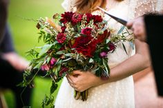 bohemian wildflowers bridal bouquet: deep burgundy dahlias, cattails, jasmine vine, eucalyptus, wax flowers & bay leaves. new orleans RAMOS wedding. ©Stevie Ramos photography