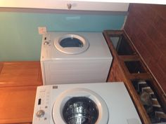 My laundry room! Doggy bed below.Husband made the washer & dryer stands.