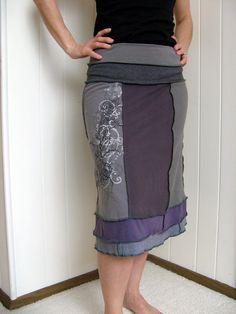 Turnaround Designs upcycled tshirt skirt. {I see a lot of people on Etsy do this. But need a serger to do it with. :( Maybe some way to do it with a special sewing machine foot or something?}