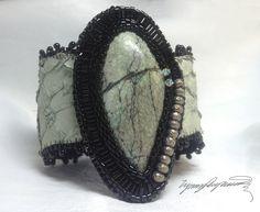 https://www.etsy.com/shop/LynnParpard?ref=listing-shop-header-item-count One of a Kind ART Piece made one bead at a time  Stunning Turquoise on cuff with fish skin & ultra suede.  This could be in your collection.  Cabochon from Last Sierra.