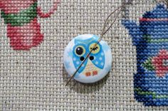 Never lose a needle again! This beautiful blue owl needle minder is made with wooden buttons and strong magnets! The back magnet has a Needle Minders, Magnets, Owl, Strong, Buttons, Christmas Ornaments, Holiday Decor, Blue, Beautiful