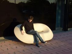 Public bench / original design / engineered stone / with backrest BLOW UP by Mansilla and Tuñón Escofet