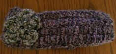Ear warmer with flower sewn on.