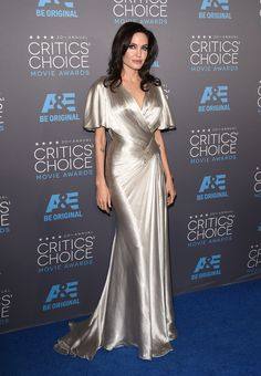 She stunned at the Critics' Choice Awards in this wrap waist, flutter-sleeved silver gown by Atelier Versace.   - MarieClaire.com