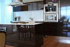 Contemporary kitchen design with sleek dark wood cabinets. Discovered on www.Porch.com Contemporary Kitchen Cabinets, Contemporary Kitchen Design, Dark Wood Cabinets, Kitchen Cabinet Design, Pantry, Porch, Modern, Table, House