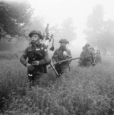 Bagpiper leading an advance during Operation Epsom, June 1944.