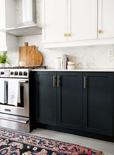White kitchen uppers mixed with inky black base cabinets warmed with matte brass hardware and vintage runner. White kitchen uppers mixed with inky black base cabinets warmed with matte brass hardware and vintage runner. Black Kitchen Cabinets, Kitchen Cabinet Design, Black Kitchens, Home Kitchens, Base Cabinets, Kitchen Counters, Small Kitchens, Navy Kitchen, Green Cabinets