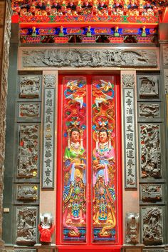 Door of the Temple for the Land God, Panchiao, Taiwan.  (Very unusual to see female door guards.)