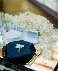 Formal Modern Classic // Wedding reception with white irises and orchids in the centerpieces