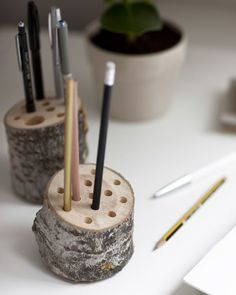 Repurpose your old Christmas tree trunk as a pen pot