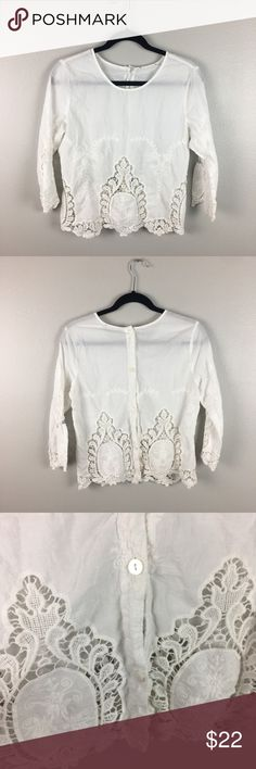 Eyelet Blouse With Button Back Stunning eyelet lace blouse. Brand tag has been removed. Gorgeous details including mother of pearl buttons down the back. Not sure on size but my guess would be a small. Tops Blouses