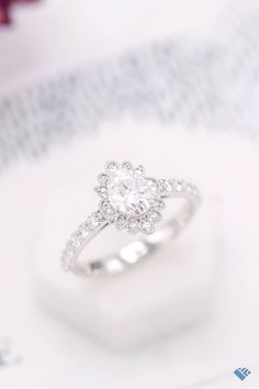 """What a pretty, floral halo with so much vintage styling! Graceful, milgrain-lined curves, and tons of sparkle all along the band. Andrew worked with us to design this ring for his partner, and he left us the kind of review we just love to see: """"This was the best experience ever!!! It turned out better than I could've ever hoped!"""" 💗⠀ Classic Engagement Rings, Moissanite Rings, Her Style, Ring Designs, Halo, Curves, Sparkle, Wedding Rings, Unique"""