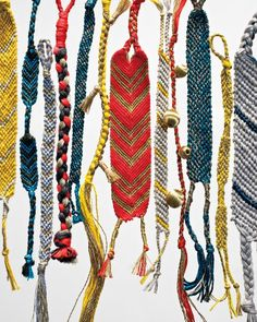 Friendship Bracelets, All Grown Up by marthastewart: It's the same technique practiced by summer campers everywhere. But when fashioned in sophisticated colors and luxurious strings and yarns with metallic accents, these knotted bracelets become great adult accessories. #Crafts #Friendship_Bracelets
