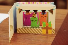 Cat tunnel book by Kitiya Palaskas | this could be a really fun invite with the teddy bears picnic theme