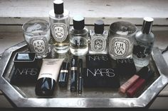 I love the idea of a serving tray for toilette items...chic way to stay organized