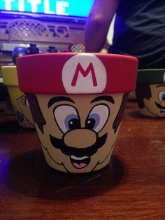 luigi painted flower pot to hold luigi lemon drops candy super mario bros birthday. Black Bedroom Furniture Sets. Home Design Ideas