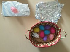 Simple Easter activity: easter egg deconstruction. Children challenge cognitive and hand-eye coordination to wrap eggs in foil.
