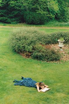 One of my favorite pasttimes. Lying in the grass reading a good book. Photo in Vogue UK