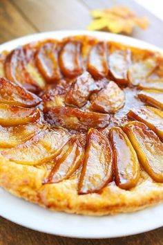 Apple Tarte Tatin1 sheet puff pastry  4 tbsp. salted butter  4 tbsp. granulated sugar  5-6 apples, peeled, cored and quartered (Golden Delicious apples are best)