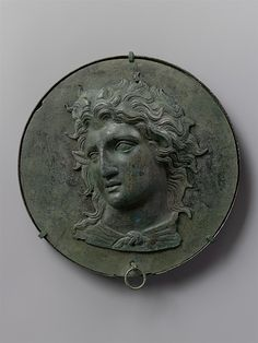 Bronze box mirror with the head of Pan, late 5th C BCE. From the collection of the Metropolitan Museum of Art.