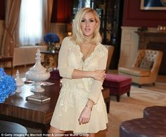 Strike a pose: Ellie stood in the lavish hotel room holding her arm with her hand, as she ...