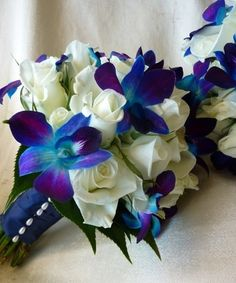 """My """"something blue"""" in the bouquet, and still has our purple wedding color - love this"""