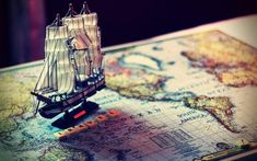 This HD wallpaper is about brown and white ship miniature, sail ship miniature on map, world, Original wallpaper dimensions is file size is Travel Wallpaper, Hd Wallpaper, West Indies Style, Healthy Living Magazine, Hacks, Wallpaper Pictures, Travel Scrapbook, Packing Tips For Travel, Italy Travel