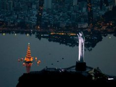 Floating Christmas Tree at the Lagoon and the Christ at the top of the mountain